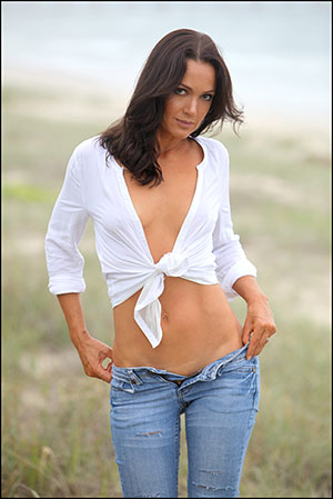 Model mother sphotographed on Tweed coast beach, jeans loose white shear shirt, brunette model. Gold Coast, Byron Bay
